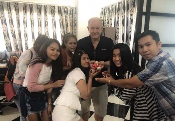 thai888 law office staff with the boss as it was his birthday 2018